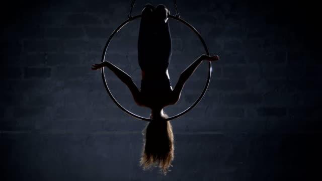 Flexible-girl-hangs-upside-down-in-the-aerial-hoop