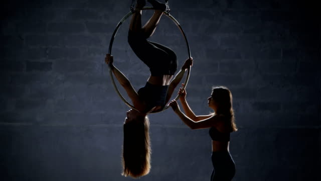 The-girl-helps-her-partner-to-do-the-trick-on-the-aerial-hoop