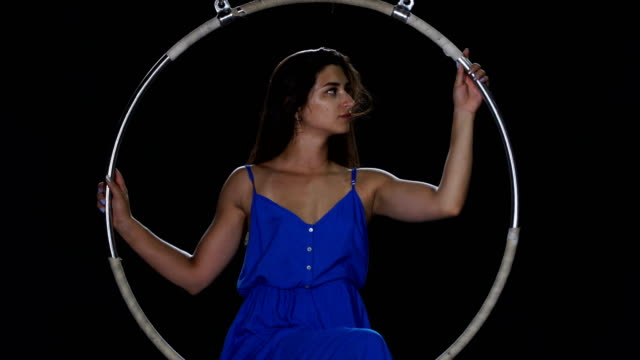 Portrait-of-beautiful-girl-in-blue-dress-in-the-aerial-hoop