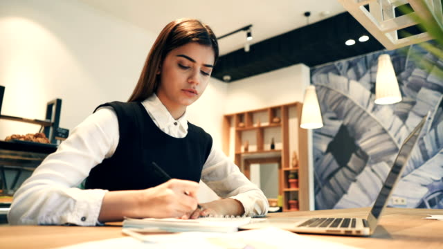 The-attractive-woman-working-at-the-desktop-with-a-modern-laptop
