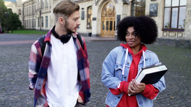 Two-Students-International-Couple-walking-at-the-College-Campus