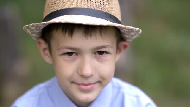 portrait-of-a-pensive-shy-boy-outdoors-close-up