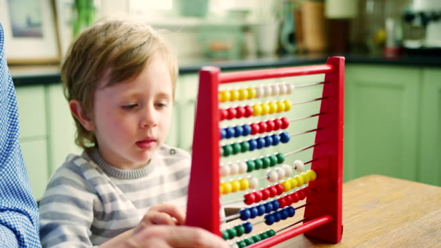 Father-Teaching-Son-To-Count-Using-Abacus