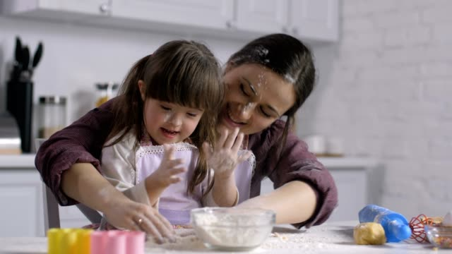 Mom-and-child-with-down-syndrome-playing-with-flour
