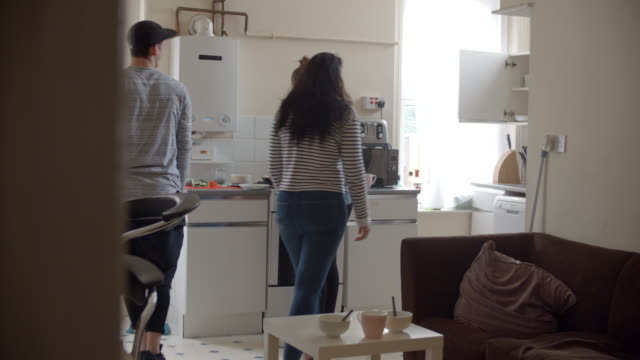 Group-Of-Students-Cooking-Meal-In-Shared-House