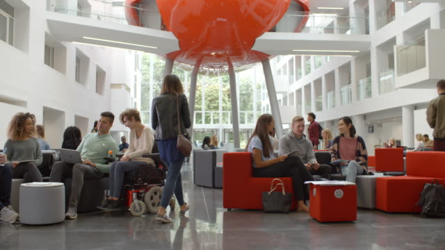 Students-socialising-in-the-lobby-of-a-university-low-angle