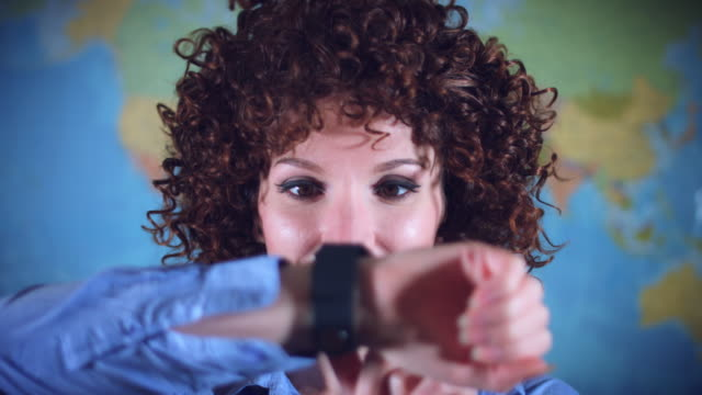 4K-Teacher-or-Student-Woman-with-Curly-Hair-Checking-her-Smartwatch