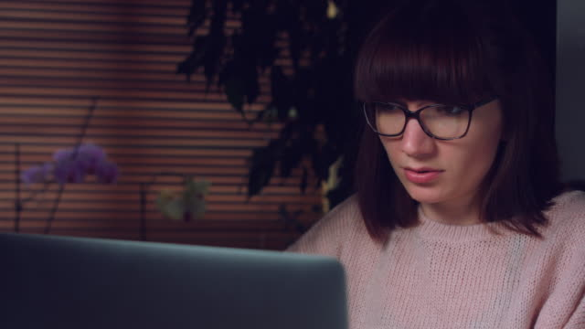 4K-Corporate-Shot-of-a-Business-Woman-Working-on-Computer-Taking-Happy-Banana