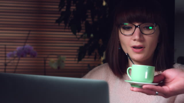 4K-Corporate-Shot-of-a-Business-Woman-Working-on-Computer-with-a-Cup-of-Coffee