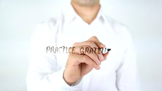 Practice-Gratitude-Man-Writing-on-Glass