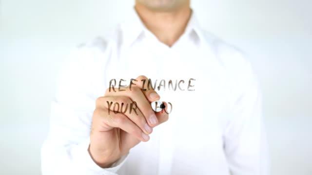 Refinance-Your-Home-Man-Writing-on-Glass