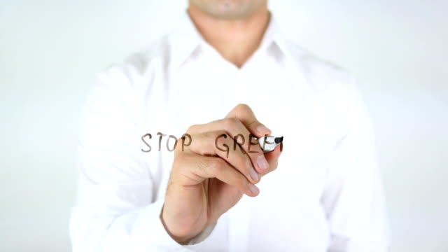 Stop-Greed-Man-Writing-on-Glass