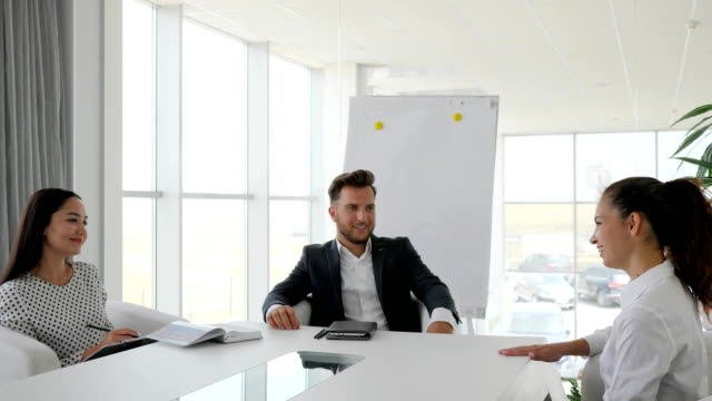 candidate-during-job-interview-into-large-company-in-white-and-spacious-office-dialog-on-job-with-secretary-and-boss