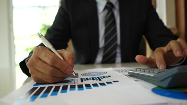 Asian-Businessman-discussion-and-analysis-data-at-office-