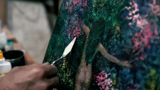 The-work-of-the-artist-with-acrylic-paint-and-a-palette-knife-(spatula)-Macro-4K