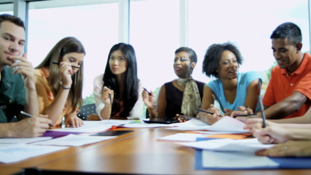 Multi-ethnic-teenagers-with-African-American-female-tutor
