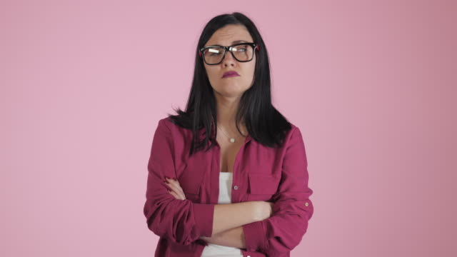 Serious-sad-depressed-young-woman-in-pink-shirt-isolated-on-colorful-background-Close-up-of-angry-frustrated-student-or-business-woman-girl-in-glasses-4k