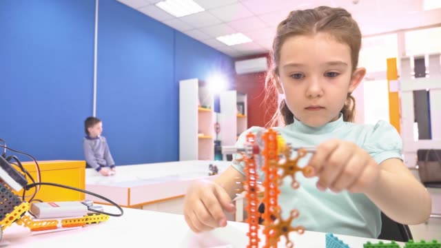 Children-creating-robots-at-school-stem-education-Early-development-diy-innovation-modern-technology-concept-