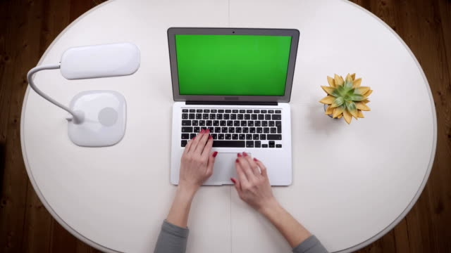 Woman-freelance-opens-a-laptop-typing-text-and-closes-it-Top-view-Hands-close-up