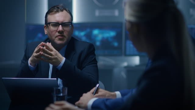 Corporate-Executive-Debates-with-His-Female-Senior-Advisor-on-a-Meeting-of-the-Board-of-Directors-Serious-Business-People:-Problem-Solving-Negotiating-and-Strategizing-in-the-Conference-Room-