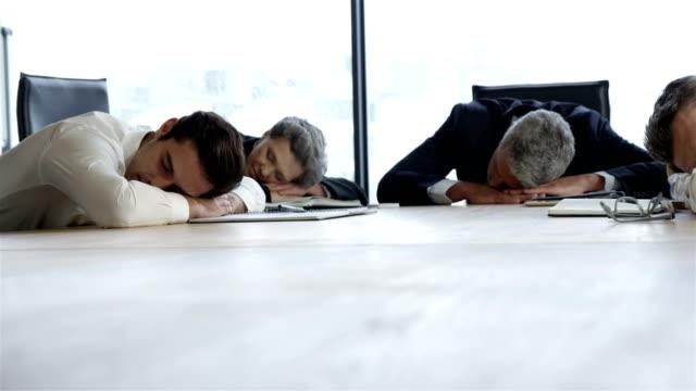 Business-people-sleeping-on-table