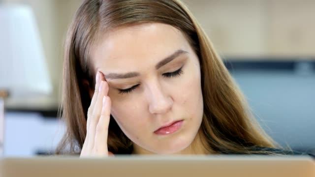 Tired-Woman-at-Work-Headache
