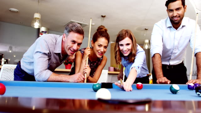 Executives-playing-pool-in-office