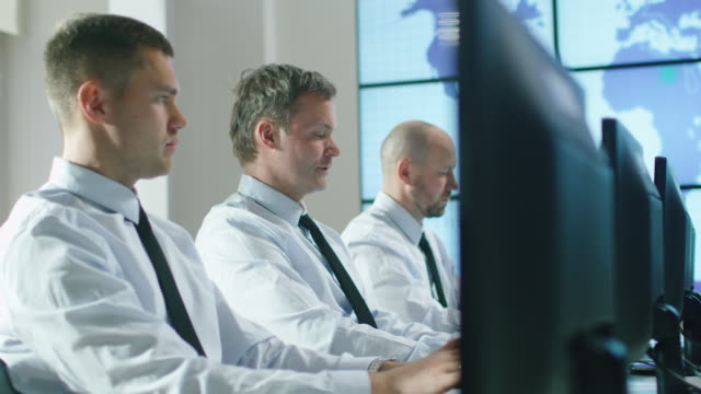 Team-of-IT-Professionals-Working-at-the-Computers-in-Bright-Office-