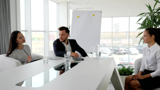 personnel-management-boss-with-secretary-holding-Job-interview-in-boardroom-business-meeting-of-businesspeople