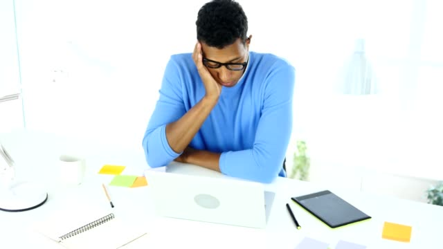 Afro-American-Creative-Designer-Sleeping-in-His-Office