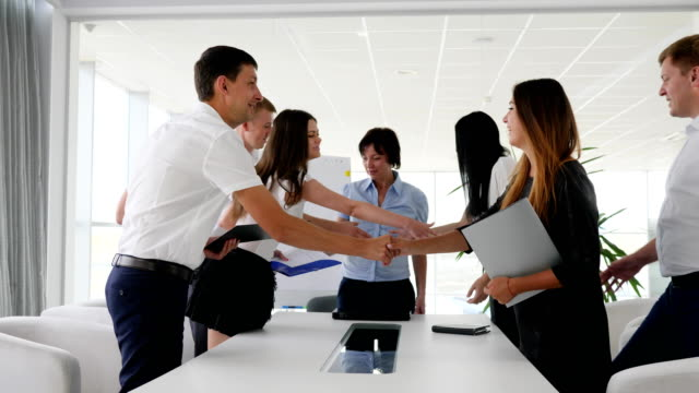 Successful-Executives-Shaking-Hands-With-Each-Other-on-meeting-in-boardroom-in-Business-center