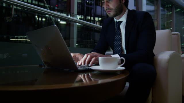 Western-European-businessman-laptop-smart-phone-night-hotel