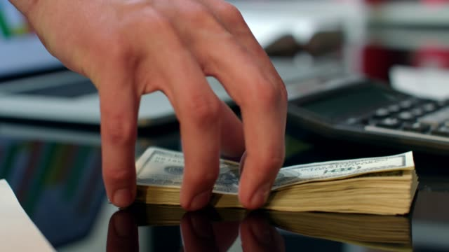 Transfer-heap-of-dollar-banknotes-from-hand-to-hand-Instant-money-transfer
