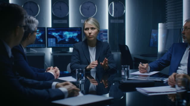 Portrait-of-the-Strong-Minded-Businesswoman-Making-a-Speech-and-Negotiating-Business-Deal-with-Her-Partners-at-the-Meeting-