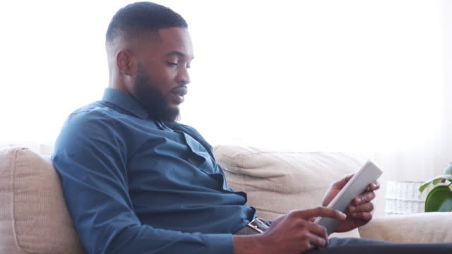 Businessman-using-digital-tablet-at-office