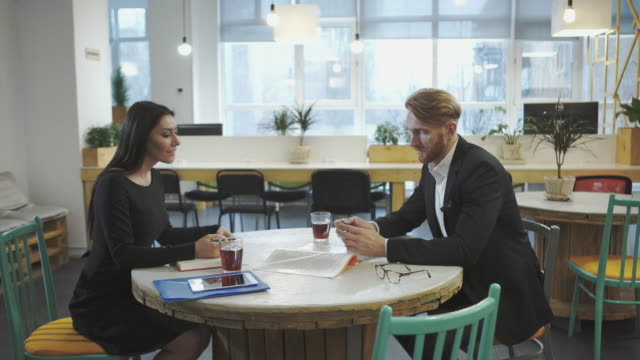 Business-Partners-at-the-meeting-Lady-discusses-strategy-with-a-man