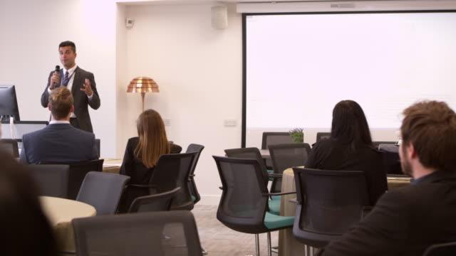 Businessman-Making-Presentation-At-Conference-Shot-On-R3D