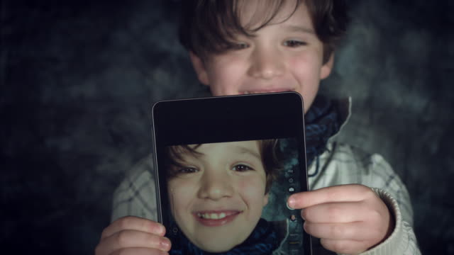 4K-Hi-Tech-Shot-of-a-Child-Doing-a-Selfie-on-his-Tablet