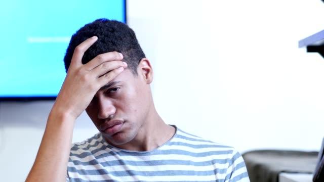 Headache-Upset-Tense-Young-Black-Man