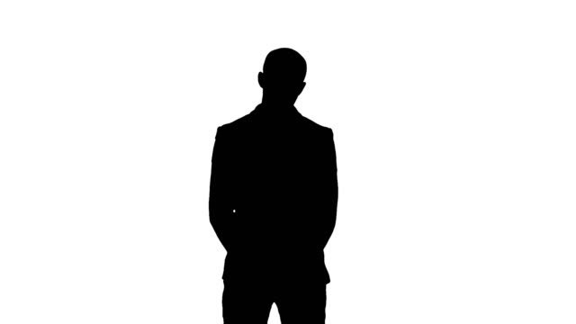Silhouette-Businessman-presenting-project-looking-at-camera
