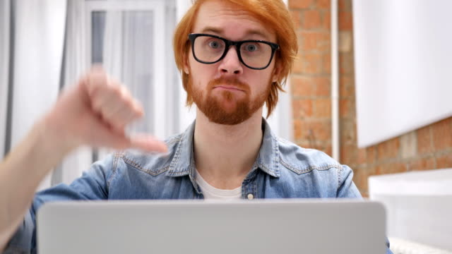 Thumbs-Down-by-Redhead-Beard-Man-Disliking-and-Rejecting-at-Home