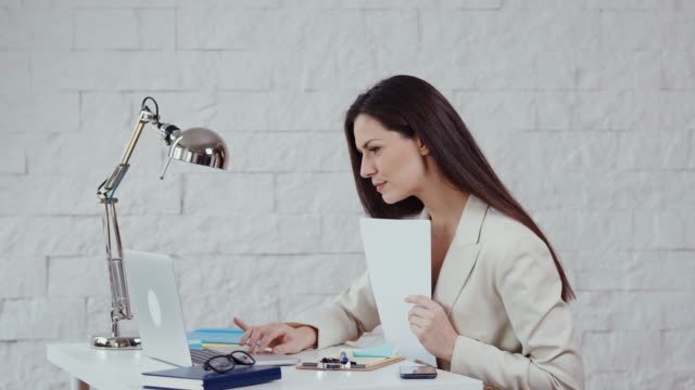 beautiful-young-businesswoman-working-with-documents