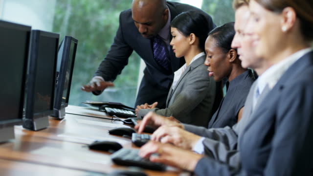 African-American-male-financial-trading-supervisor-with-team