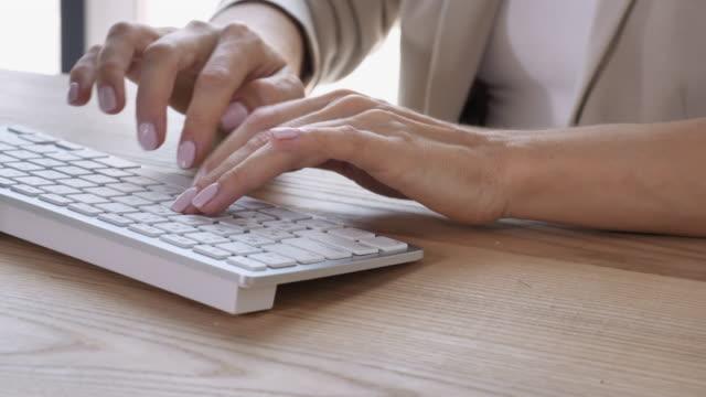 female-fingers-fast-entering-data-on-pc-