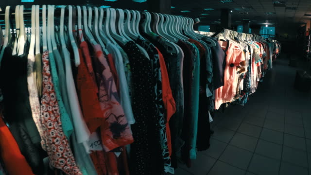 Rows-with-clothes-on-hangers-hang-in-the-second-hand-shop-View-inside-the-shopping-center