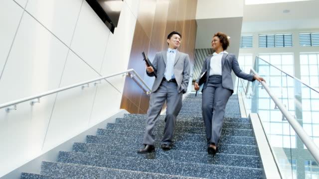 Multi-ethnic-male-female-real-estate-team-meeting