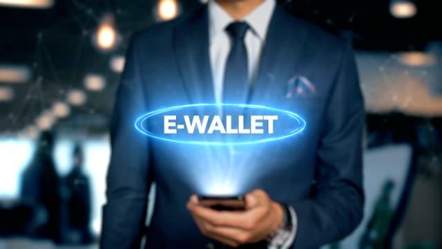 Geschäftsmann-mit-Handy-öffnet-Hologramm-HUD-Interface-und-Berührungen-Word---E-WALLET