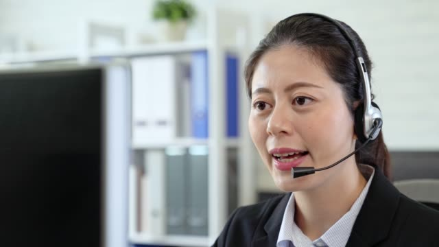 Asian-girl-sitting-at-computer-with-the-headphone