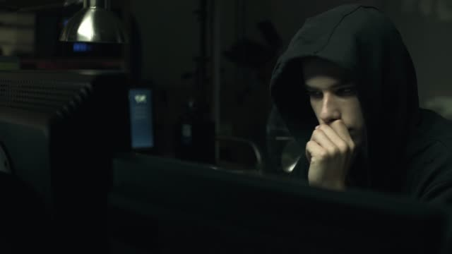 Hacker-connecting-with-his-computers-in-a-dark-basement