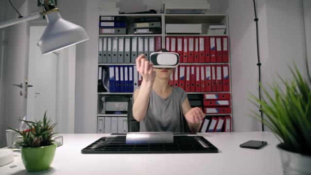 Woman-using-virtual-reality-simulator